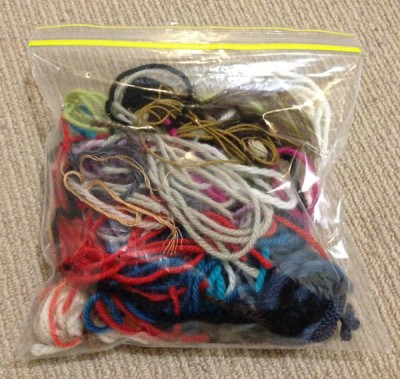 Ziplock plastic bag containing yarn ends