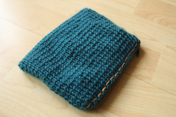 Knitting Zipper Tutorial : Knitted zippered and lined pouch with a crochet flower