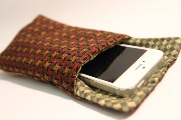 Phone swimming around inside the pouch.