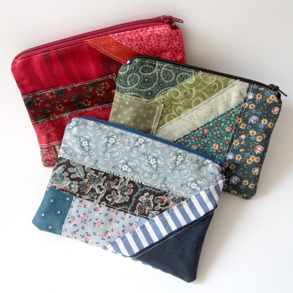 Fabric jumble zip pouches in red, green and blue colour schemes