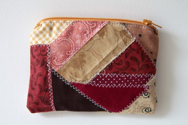 A scrap fabric zipper pouch showing fraying edges on some of the pieces