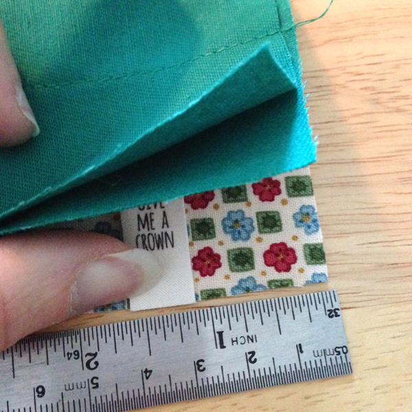 Sew-in label placement while sewing