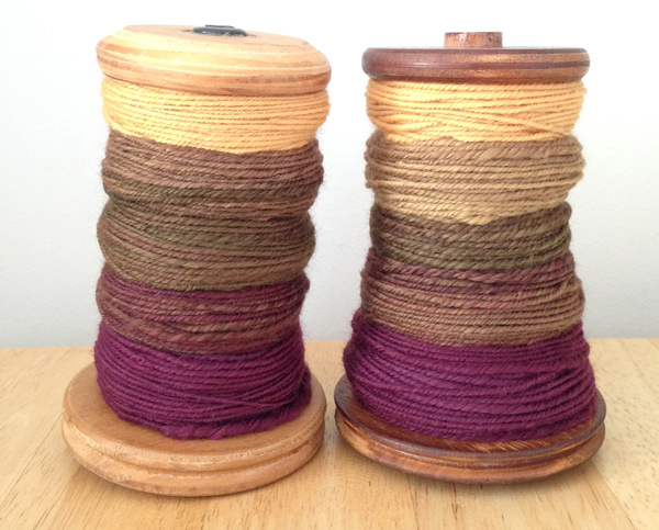 Two bobbins of chain plied yarn