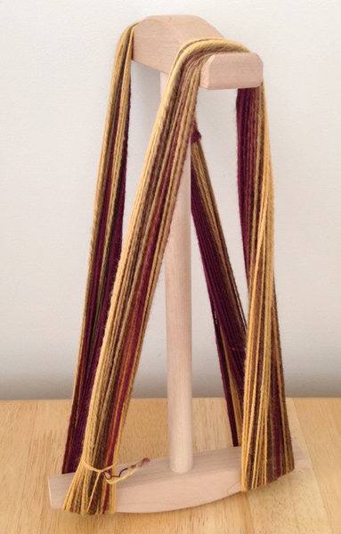 Hand spun yarn on a niddy noddy